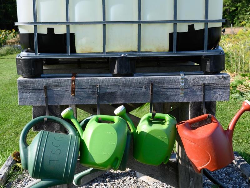 Closeup of water buckets at community garden