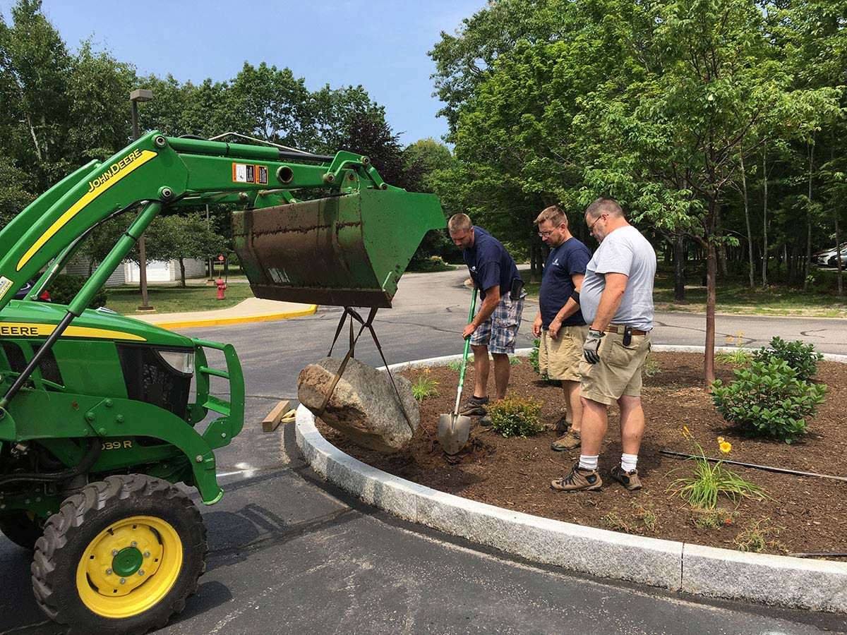 Maintenance team working on landscaping